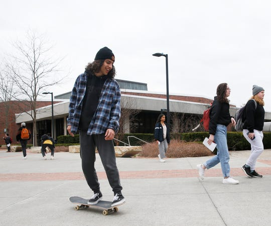 Kyle Zeno of Wallkill rides his skateboard to class at SUNY New Paltz on March 12, 2020.