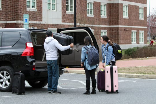 Saloni Rastogi and Faith Goetzke, University of Delaware freshman, pack up to leave campus after the school suspended in-person classes Wednesday afternoon following the first presumptive positive case of coronavirus in the state.