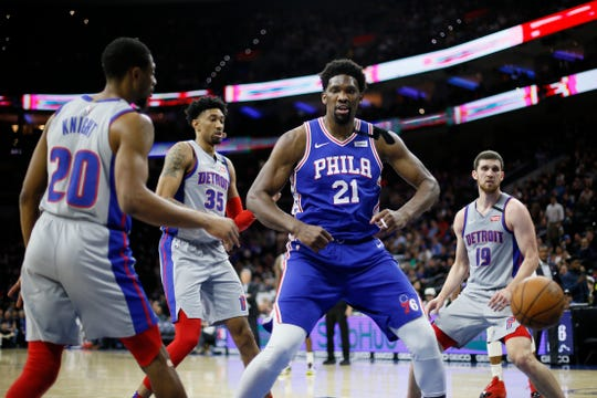 Philadelphia 76ers' Joel Embiid (21) reacts after a dunk during the second half of an NBA basketball game against the Detroit Pistons, Wednesday, March 11, 2020, in Philadelphia. (AP Photo/Matt Slocum)