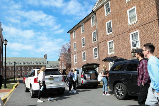 University of Delaware students packed up to leave campus after the school suspended in-person classes mid-March following the first presumptive positive case of coronavirus in the state. Classes resumed this fall largely online.