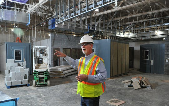 Wichita County, Precinct 1, commissioner, Mark Beauchamp gives an updated tour of the Law Enforcement Center, Thursday afternoon. The massive construction project is scheduled to be completed in August.