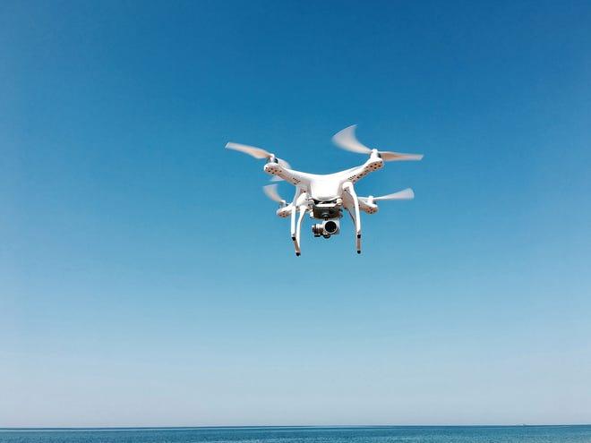Canva white drone.