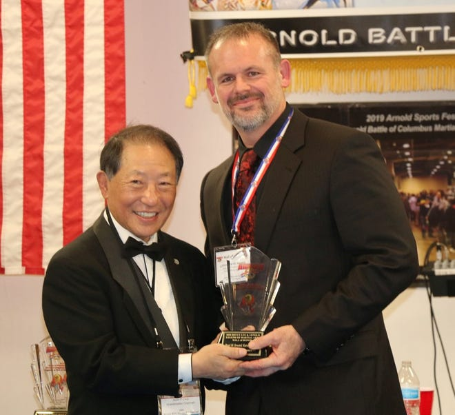 Local Master Brad M. Seward was recognized by SGM Joon Choi for his generosity, contributions and dedication in serving his community by teaching martial arts. He was inducted into the Karate Master Arnold Martial Arts Hall of Honor at last weekend's Arnold's Sports Martial Arts Festival.