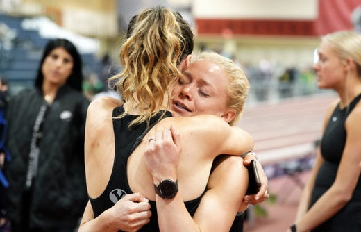 Alena Ellsworth and Anna Camp-Bennett of BYU embrace after the NCAA Indoor Championships at Albuquerque Convention Center were cancelled because of novel coronavirus on Mar 12, 2020.