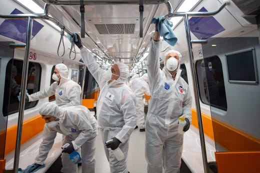 Employees of the Istanbul Municipality wearing protective gear disinfects a subway carriage to prevent the spread of the COVID-19, caused by the novel coronavirus, in Istanbul on March 12, 2020. Turkey announced on March 11, 2020 its first coronavirus case, a man who had recently travelled to Europe and is in good health.