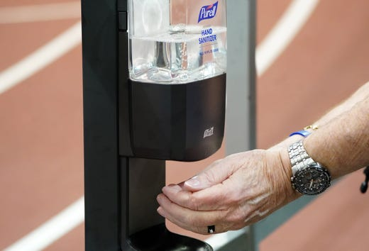 Robert Black uses a hand sanitizer dispenser prior to the NCAA Indoor Championships on Mar 12, 2020.