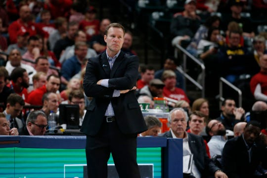 Nebraska Cornhuskers coach Fred Hoiberg coaches on the sidelines during the game against the Indiana Hoosiers before leaving the game.