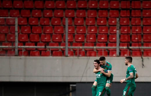 Wolverhampton Wanderers' Pedro Neto, left, celebrates with teammates in an empty stadium on March 12, 2020.