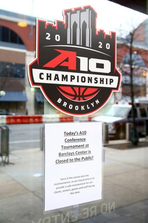 A sign stating that the 2020 Atlantic 10 Men's Basketball Tournament is closed to the public is seen before the second round outside the Barclay Center on Thursday.