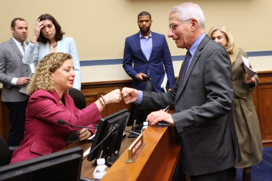 Anthony Fauci, director of the NIH National Institute of Allergy and Infectious Diseases (R) fist bumps Rep. Debbie Wasserman Schultz (D-FL)  during a House Oversight and Reform Committee hearing on Coronavirus Preparedness and Response at the Rayburn House Office Building on March 12, 2020 in Washington, DC. Health officials say 11,000 people have been tested for the Coronavirus (COVID-19) in the U.S..