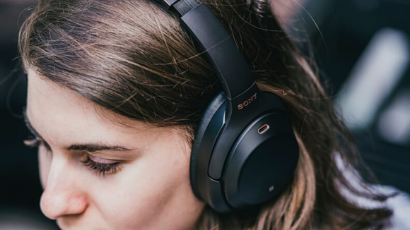 Drown out unwanted noises with noise-canceling headphones.