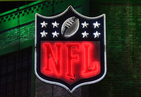Detailed view of neon NFL shield logo during the first round of the 2019 NFL Draft in downtown Nashville.