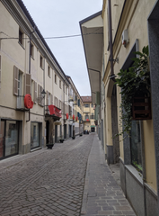 An empty street in historic center of Bra. If you notice the red snail, it's a symbol of the University of Gastronomic Sciences' presence in the town. Bra is the founding city for the Slow Food movement (hence the snail).