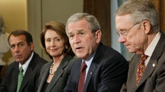 President Bush, second from right, meets with Congressional leaders to discuss the economy, Tuesday, Jan. 22, 2008, in the Cabinet Room of the White House in Washington. From left are, House Minority Leader John Boehner of Ohio, House Speaker Nancy Pelosi of Calif., the president and Senate Majority Leader Harry Reid of Nev.