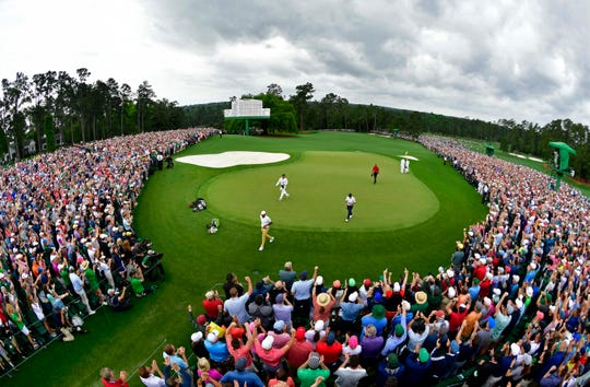 Apr 14, 2019; Augusta, GA, USA; Tiger Woods walks off the 18th green after winning The Masters golf tournament at Augusta National Golf Club.