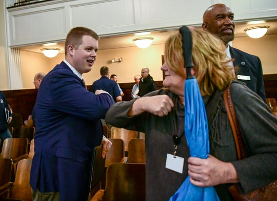 Kyle Newton, left, Anderson School District 5 assistant superintendent, and Anderson city ouurt Administrator Kimberly Poulin bump elbows after the Anderson County officials conference to discuss handling COVID-19, in the county council chambers Friday, March 13, 2020.