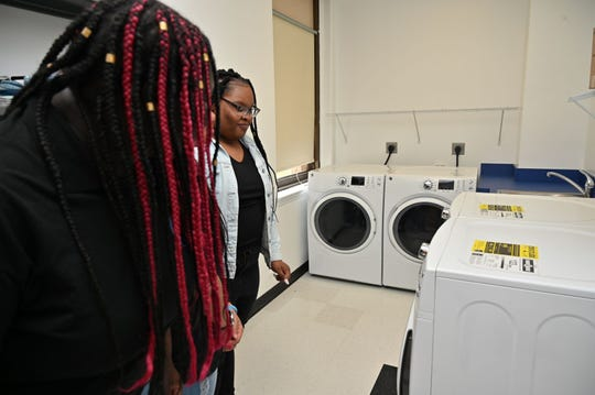 Students marvel at the new front-loading washers and dryers in the Asbury Park High School Legacy Center.
