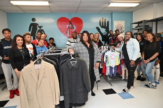 Asbury Park School District board of education members, administrators, staff, students and Social Conscience Project volunteers enjoy the space during the grand opening.