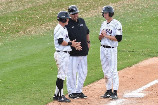 ardin-Simmons coach Steve Coleman talks to Cade Johnson (1), left, and Jacob Rains (3) during a pitching change against Schreiner at Hunter Field on March 10. The Cowboys won 13-10 for Coleman's 501st career victory.