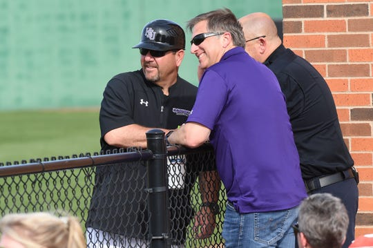 Hardin-Simmons head coach Steve Coleman, left, talks to athletic director John Neese, middle, and a university police officer during a break in the game against Schreiner at Hunter Field. Coleman won his 500th career game on March 6, 2020.