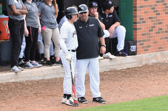 Hardin-Simmons coach Steve Coleman talks to Jared Kivett (8) before an at bat against Schreiner at Hunter Field on Tuesday. Coleman has led the Cowboys to 17 ASC tournaments with three finals appearances.
