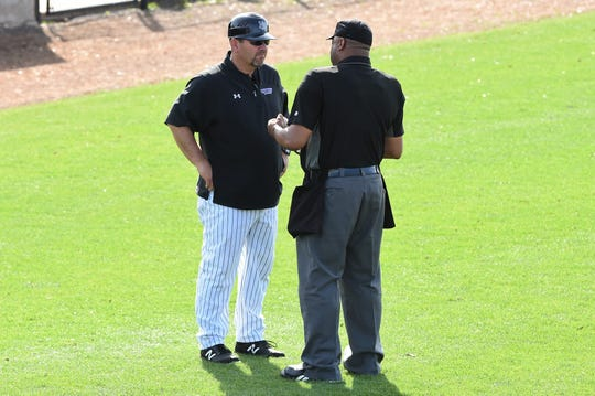 Hardin-Simmons coach Steve Coleman talks to the home plate umpire between innings against Schreiner at Hunter Field on Tuesday. Coleman's first season with the Cowboys came in 1998, he won his 500th career game earlier this season.
