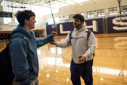 Lakeview seniors Jackson Kitchen and Kosta Sevastopoulos goof off in the gym as school is dismissed at 10:55 a.m. on Friday, March 13, 2020 after Gov. Gretchen Whitmer closed K-12 schools to limit the spread of COVID-19. Sevastopoulos and Kitchen's senior year of baseball is suspended indefinitely due to the presence of COVID-19 in Michigan.