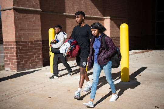 Lakeview senior Zaccur Lane and junior Amari Ashley leave school at 10:55 a.m. in Battle Creek, Mich. as Gov. Gretchen Whitmer closes K-12 schools in hopes of limiting the spread of COVID-19 on Friday, March 13, 2020.