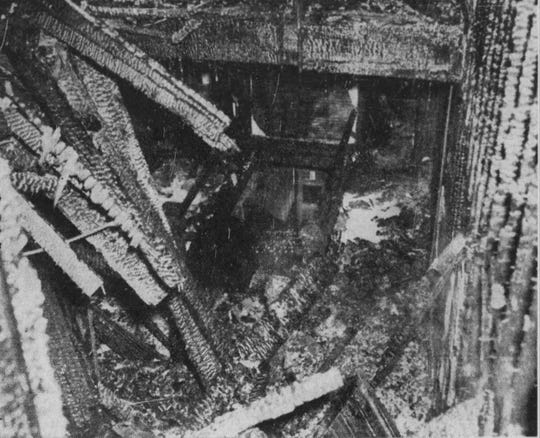 The rubble of the fourth floor and roof rest on the third floor of the building in 1943.