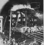 Firefighters struggle to put of the fire at the Wilkinson Block, at Front and Main streets in 1943.