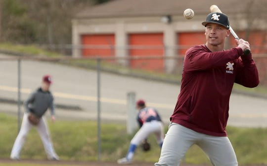 South Kitsap baseball head coach Marcus Logue hits balls to his outfield during practice at South Kitsap High School in Port Orchard on Thursday, March 12, 2020.