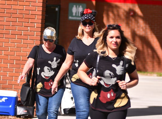 Susan Schiumo, Janie Leonard and Paige Castella prepare to board the Disney Dream at Port Canaveral. They were going to surprise Susan's daughter, who works on the ship.