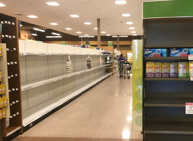 Shelves were empty in Publix on Friday, as shoppers bought up Things sold out: thermometers, medicines, rubbing alcohol, paper products, dry goods, pasta and canned goods.