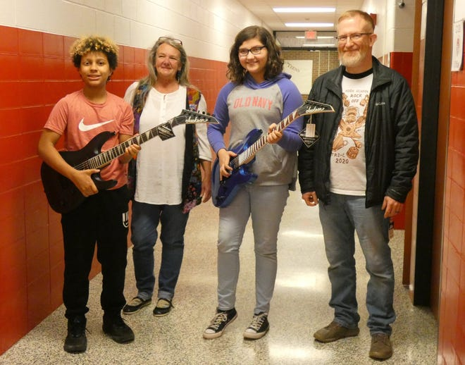 On Friday, two Bucyrus sixth-graders received  brand-new Jackson guitars, the result of a Crawford County Arts Council fundraiser that took placelast spring. From left are Maseo Hall, Beverly Morgan, Adalyn Zorns and Mark Fiske.