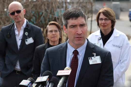 University of Vermont Medical Center president Dr. Steven Leffler addresses a gathering of media regarding a patient being treated outside the University of Vermont Medical Center in Burlington, Vt., Thursday, March 12, 2020. The Vermont Department of Health identified the patient as a new presumptive positive case of novel coronavirus, or COVID-19, in Vermont. For some, especially older adults and people with existing health problems, it can cause more severe illness, including pneumonia.