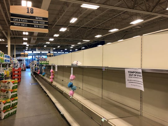 "A toilet paper aisle is ""temporarily out of stock"" at the Shaw's grocery store on Shelburne Road in South Burlington on March 13, 2020."