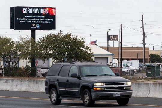 A billboard near the Crosstown Expressway on Friday, March 13, 2020, displays information about the coronavirus and the hotline set up by the City of Corpus Christi and local health district.