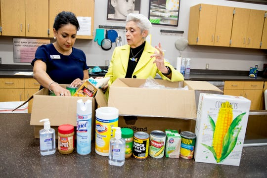 City Councilwoman At-large Paulette Guajardo (left) and Bea Hanson, executive director of the Coastal Bend Food Bank, talk about some of the items that could be included in emergency food and cleaning boxes to be distributed to low-income elderly residents as fears of COVID-19 increase.