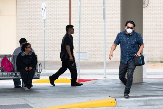 A man wears a mask at the  Corpus Christi Regional Transportation Authority's Staples Street Station on Friday, March 13, 2020, as the coronavirus continues to spread in Texas.