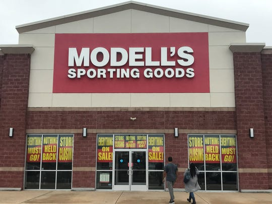Shoppers enter a Modell's Sporting Goods store that's holding a final sale at the Pavilions shopping center on Route 70 in Cherry Hill.