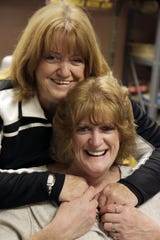APRIL 16, 2009: Dixie Sucher, top, hugs daughter Kelly Chambers.  Kelly suffers with AIDS. Kelly and her mother run the organization For Aids Children Everywhere, also called F.A.C.E. in the Holmes building on the UC Medical Center campus.