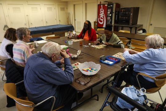 People gather to play bingo together at the Hyde Park Center for Older Adults on Friday March 13, 2020. The center will be closing next week due to novel coronavirus.