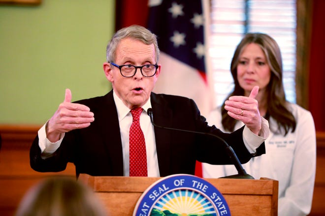 Ohio Gov. Mike DeWine addresses members of the media during a press conference updating the public on COVID-19 on Thursday, March 12, 2020 at the Statehouse in Columbus, Ohio.
