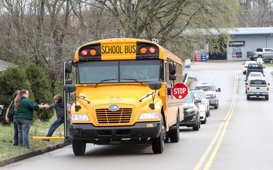 Students get off the bus on the day before schools in Montgomery County closed over fears of COVID-19 on Glendale Drive in Clarksville, Tenn., on Thursday, March 12, 2020.