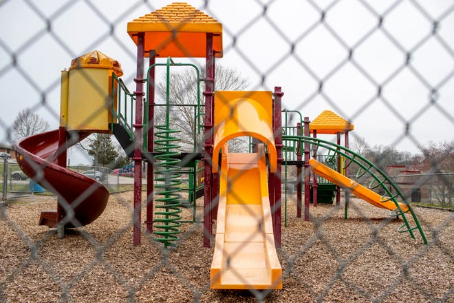 An empty playground sits outside a closed Moore Magnet Elementary in Clarksville, Tenn., on Thursday, March 12, 2020.