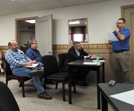 Coshocton County IT Director Mike LaVigne, standing, addresses how county employees can work from home. Listening are Danny Brenneman of Coshocton County Job and Family Services, Coshocton County Health Commissioner Steve Lonsinger and Prosecutor Jason Given.