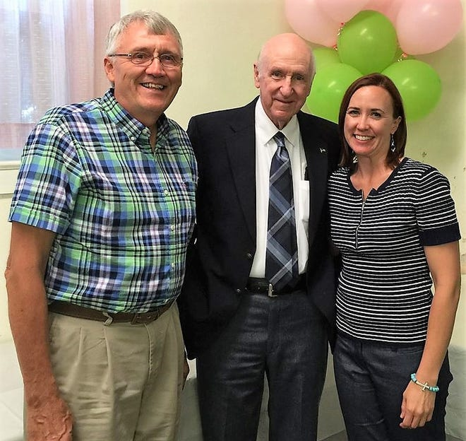 Emily Marrison and her father Robert Buxton with their agriculture teacher, Ray Griffith, who influenced many in Coshocton County's agricultural community and beyond.