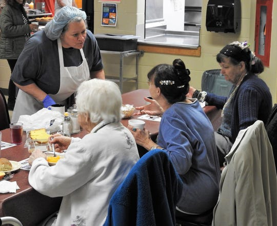 Beth Vojacek serves people Friday at the Coshocton County Senior Center. Fish was the main course for Lent.