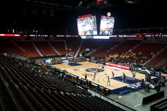 Only family and essential personnel watch the 1A state boys basketball championship game between Wapsie Valley and Bishop Garrigan on Friday, March 13, 2020, at Wells Fargo Arena in Des Moines.