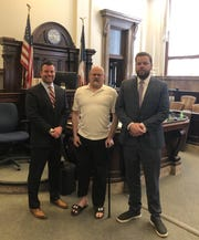 Eddie Curl is flanked by his lawyers Benjamin Tobin (left) and Patrick Sullivan in an undated photo. Tobin and Sullivan, two Illinois lawyers, helped Curl garner a $1.29 million settlement from his former employer BNSF railway after he was injured in 2015.
